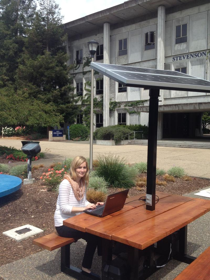 "Sarah Memmer works at the soalr-powered ""smart"" picnic table she co-designed at Sonoma State."