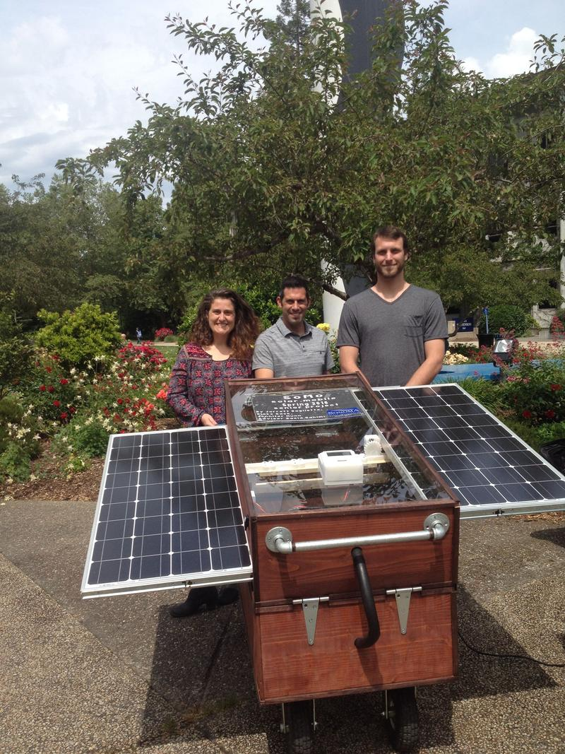 Jennifer Nunn, Jarrett Baglietto and Blake Sack designed and built the prototype SoMo solar generator they showed off at the Research and Creativity Symkposium.
