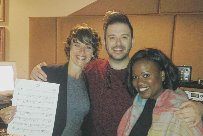 Amy Miller, Rick McKee and Q. Smith pause for a photo op during a recording session at Prairie Sun studios Monday.