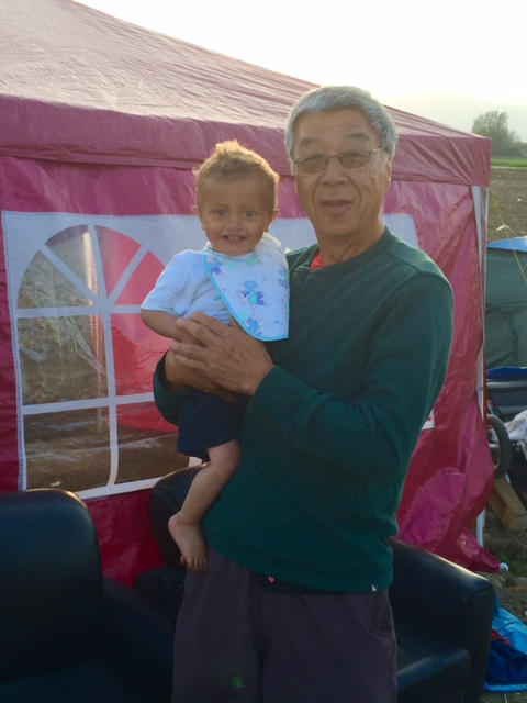 Namkung with a young friend at the  Idomeni refugee camp