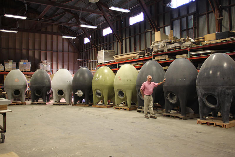 Steve Rosenblatt shows some of the exterior color choices offered for the egg-shaped concrete wine tanks his company makes in Petaluma.