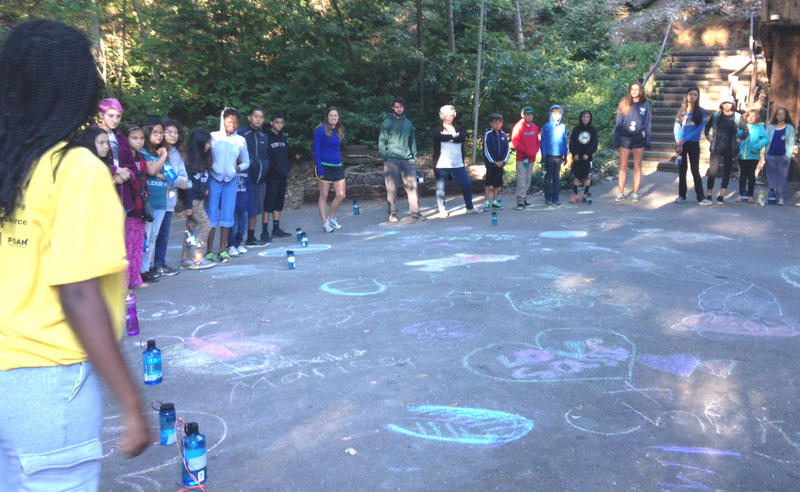 With their water bottles close at hand, organ transplant campers gather for their morning circle  at St. Dorothy's Rest this week.