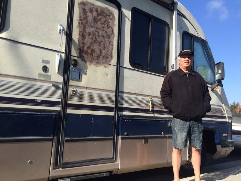 Chris Totten in front of his RV. Totten says much of the garbage motorhome owners like him are blamed for come from day laborers.