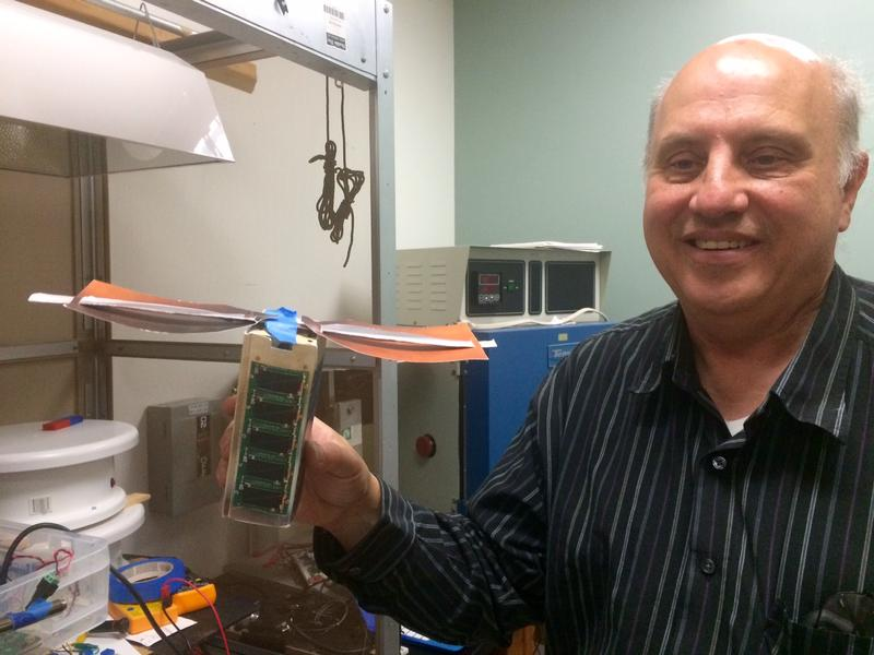 Garrett Jernigan, the project's technical lead, shows off a model of SSU's first CubeSat project called the T-Logo Cube.