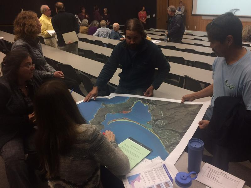 Attendees of a sea level rise workshop at the marine lab look at maps and discuss possible problem areas in and around Bodega Bay.
