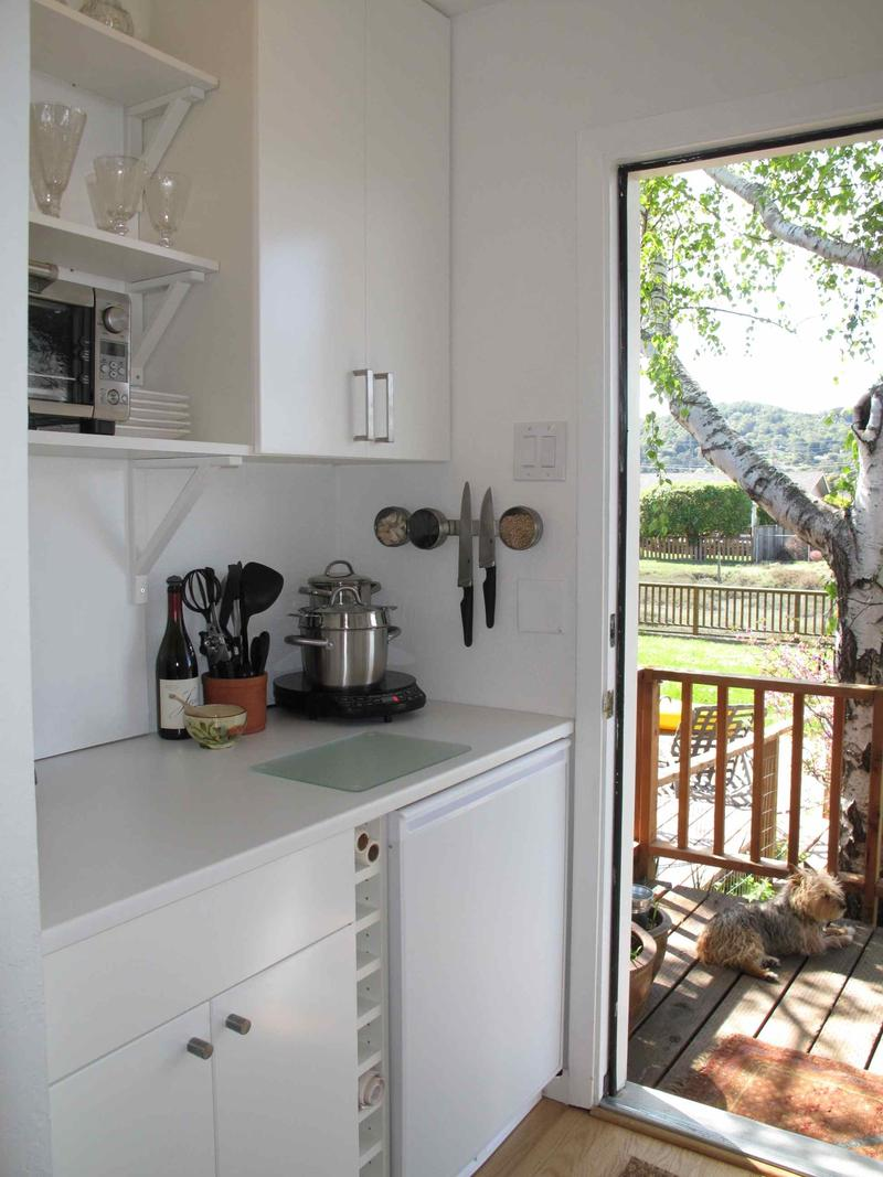 The former closet of the master bedroom was repurposed into a kitchenette with separate entrance.