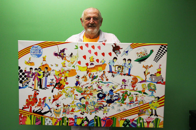 Animator Ron Campbell with a painting that incorporates the characters he worked on during his 50-year career.