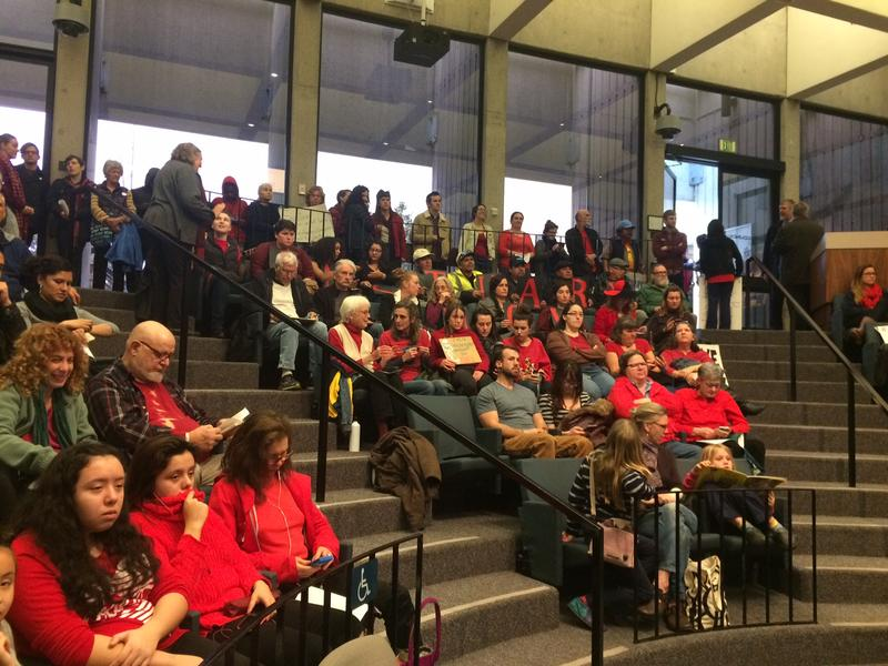 "Residents who supported the ""Indivisible City"" resolution wore red."