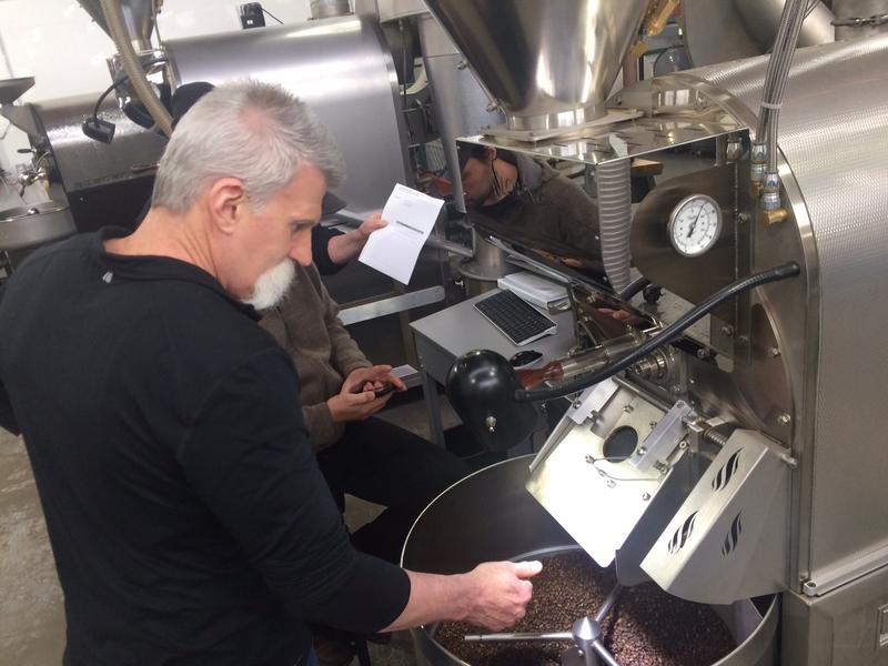 Bob Baxter checks a batch of beans he's just roasted for defects.