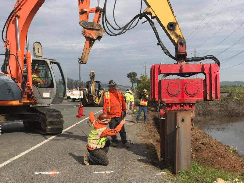Workers with Ghilotti Construction Company begin a project to temporarily fix Highway 37.