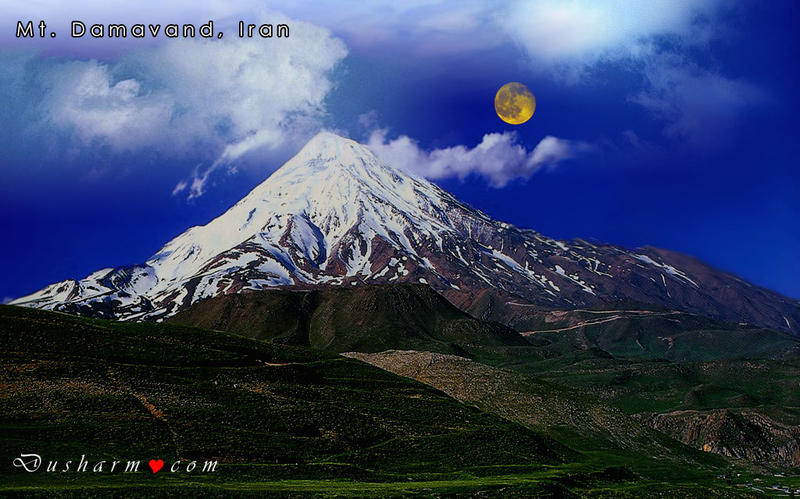Damavand is a towering volcano just 45 miles northeast of Teheran, near the Southern coast of the Caspian Sea. Its great height and classic volcanic shape, unique to the region, grant it dominance and isolation.