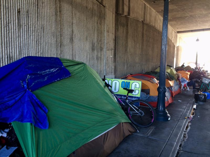 As many as 50 people a night congregate on the sidewalks at the Sixth Street underpass.