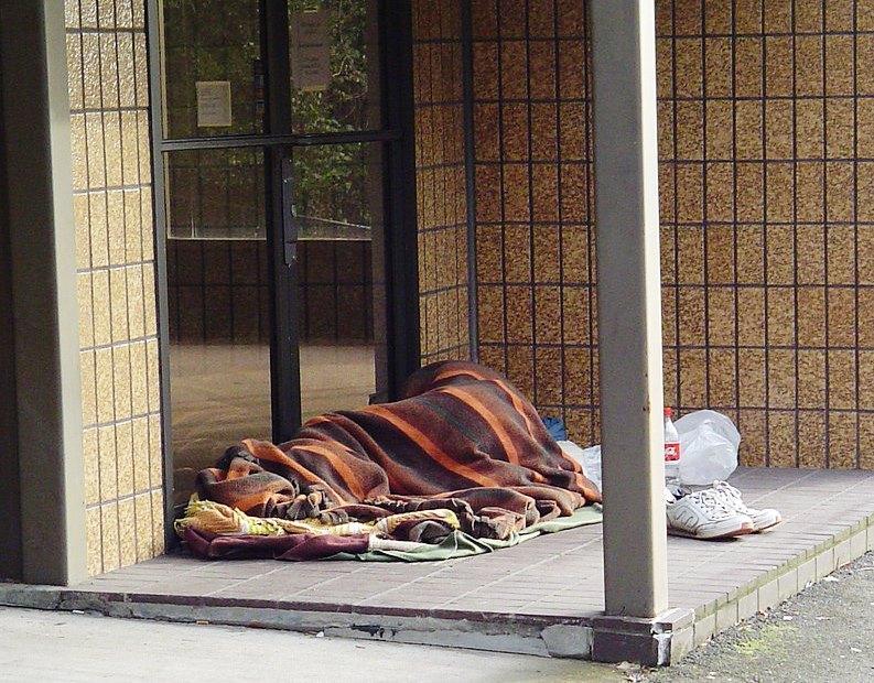 Homeless person in doorway