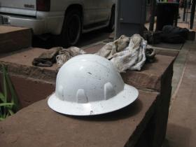 Muddy hard hat and towels in Manitou Springs on Sunday.