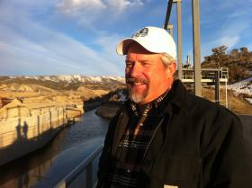 Steve Fletcher, manager of the Uncompahgre Water Users Association, stands atop one of their new hydropower stations along the UWUA's South Canal, a few miles east of Montrose.