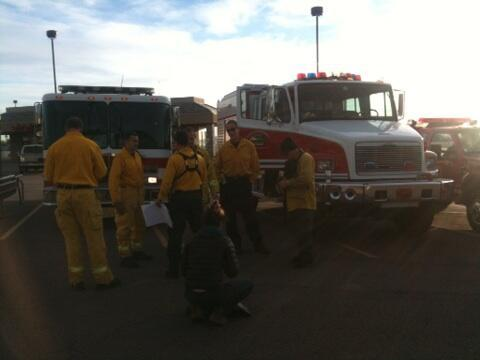 Firefighters convene in preparation for the evacuation drill.