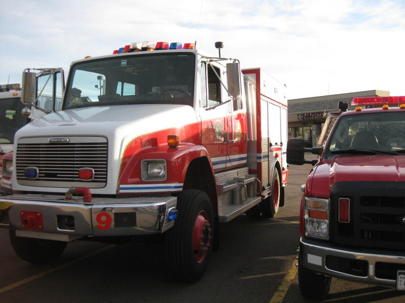 Trucks wait in preparation for the evacuation drill.