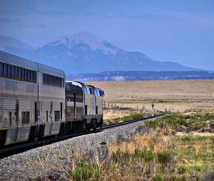 The Southwest Chief roughly 20 minutes east of Trinidad, Colorado. The Sangre de Cristo Range looms in the distance in this photo from July 2011.