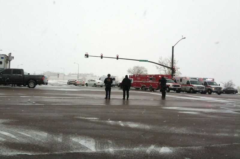 Law enforcement and other first responders block off an intersection during the active-shooter incident.