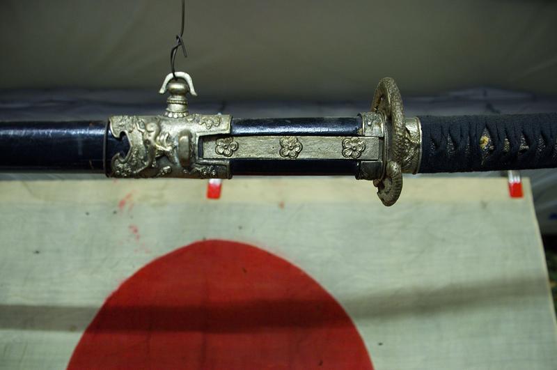 Samurai sword and WWII-era Japanese flag