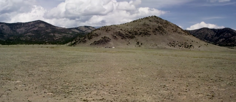 Mike Rust's home in Saguache County against Copper Butted (looking West)