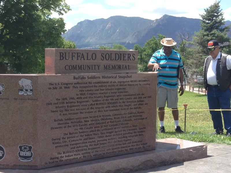 Willie Breazell and Dennis Moore of the Buffalo Soldier Community Memorial Committee stand beside the newly installed Buffalo Soldier monument in Memorial Park.