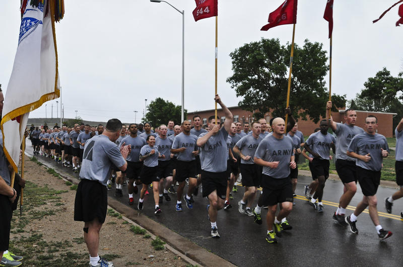 After completing a 3-mile run, Acting Senior Commander Col. Mike Tarsa, 4th Infantry Division and Fort Carson, cheers on soldiers participating in the run June 12, 2014. The division and Fort Carson ran to celebrate the Army's 239th Birthday.