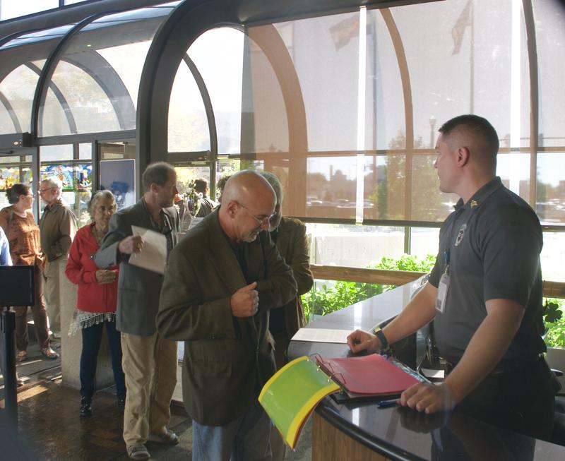 Colorado Springs residents, led by Richard Skorman, sign in at the Colorado Springs city administration building, where they began the process to get a initiative on next April's ballot to require voter approval of city parkland sales and transfers.