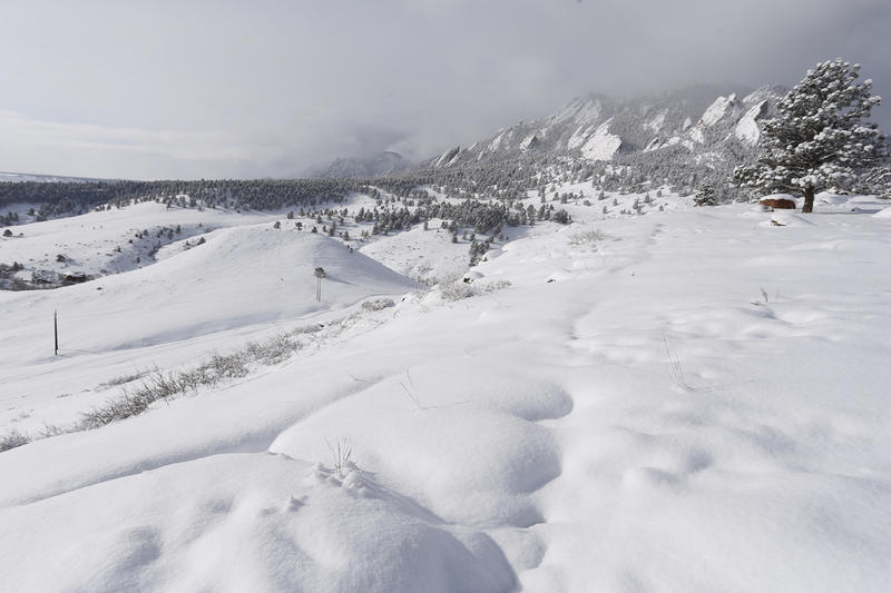 This file photo from the Associated Press shows fesh snowfall over the hills above Boulder. March 4, 2015