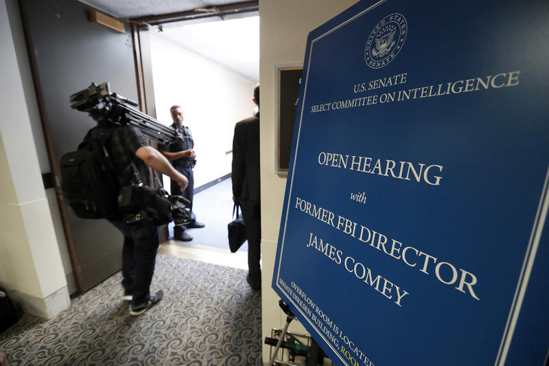 Media enter the hearing for former FBI Director James Comey's appearance before the Senate Intelligence Committee, on Capitol Hill, Thursday, June 8, 2017, in Washington.