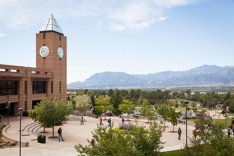 At UCCS, looking south from the Engineering and Applied Sciences Building at the foothills, students on El Pomar Plaza, and El Pomar Center bell tower.