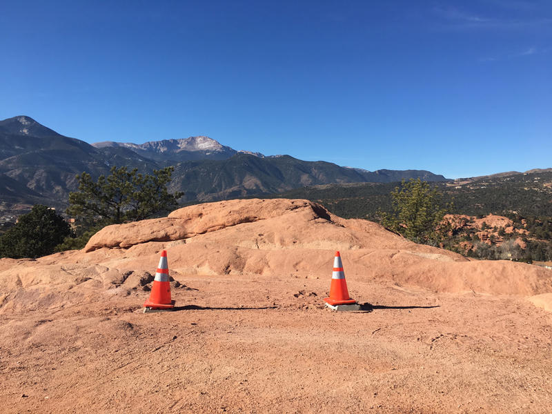 Two cones indicate where a large blue frame stood for less than a week in Garden of the Gods. The city removed the frame after public outcry.
