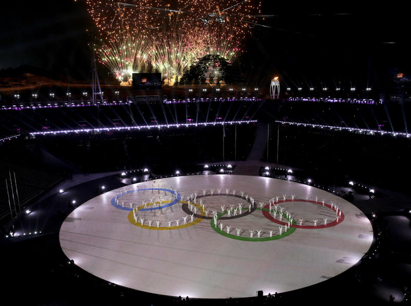 Fireworks explode as performers skate to form the Olympic rings during the closing ceremony of the 2018 Winter Olympics in Pyeongchang, South Korea, Sunday, Feb. 25, 2018.