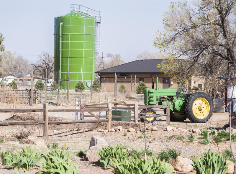 A water tank and tractor at Venetucci farm, April 2018. Water contamination in the Widefield aquifer prompted the farm to suspend a water lease with the Security and Widefield water districts in 2017, leading to the suspension of operations at the farm.