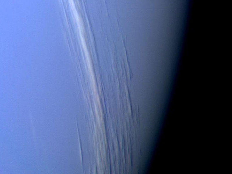 This Voyager 2 high resolution color image, taken 2 hours before closest approach, provides obvious evidence of vertical relief in Neptune's bright cloud streaks.