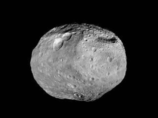 """Vesta is an asteroid. It has a set of three craters known as the """"snowman."""""""