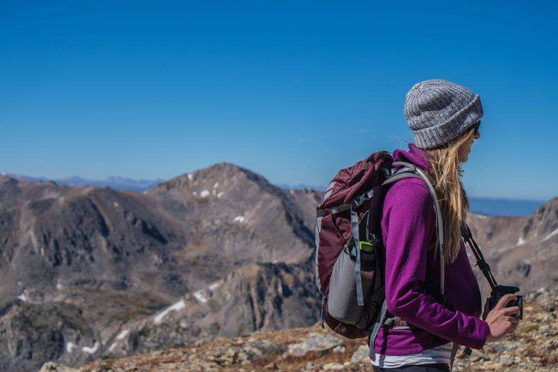 Woman in the mountains. Stock photo.