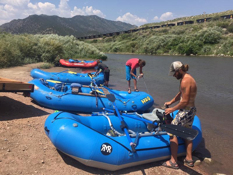 Jordan Poythress (foreground) prepares his raft to go down the Arkansas River