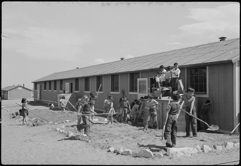 Elementary children landscaping the grounds at Camp Amache on April 24, 1943.
