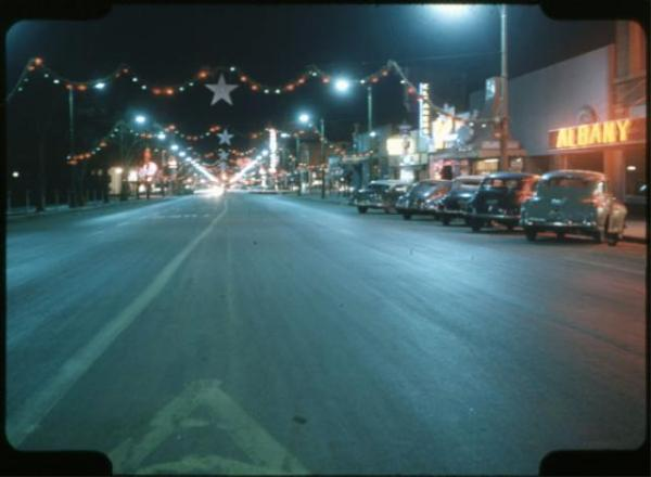 """Tejon Street at Night"" by James and Helen McCaffery, ca. 1950s. Courtesy of Special Collections, Pikes Peak Library District. Image Number: 266-10084."