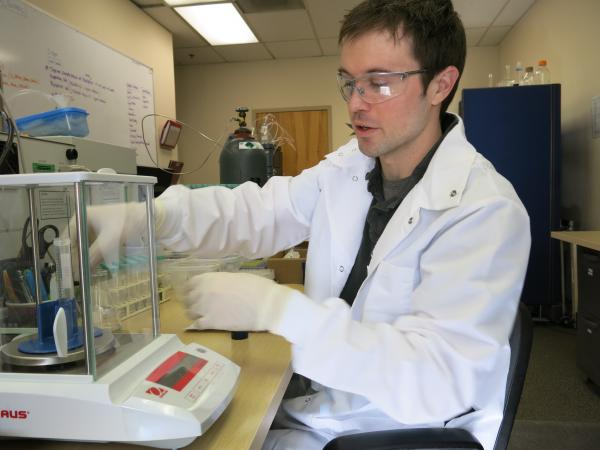 Chris Peck, a lab assistant at Denver-based CannLabs, tests a sample of marijuana. Peck tests products for foodborne pathogens, molds, chemicals, and potency.