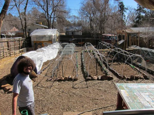 Adam Atencio in his backyard, where his garden beds are ready for another season of production.
