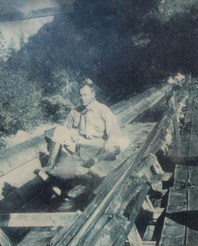 A man riding a flume provides the cover for With Water.