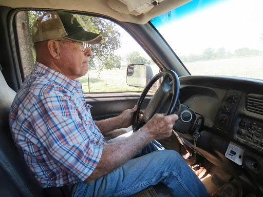 Don Proffitt, a beef cattle farmer in Pottersville, Missouri, inspects his fields for thistles.