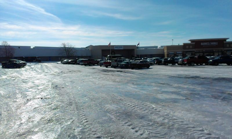 Ice covers the parking lot at West Park Mall in Cape Girardeau, Mo.