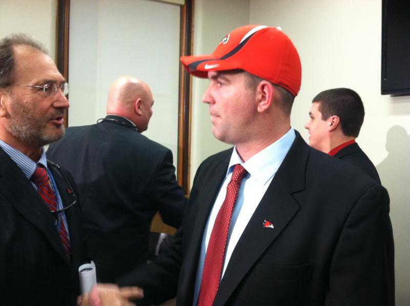 Tom Matukewicz shakes hands following his introduction as Southeast Missouri State University's new head football coach.