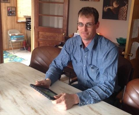 Farmer Jeff Heepke holds the iPad that includes Monsanto's FieldScripts app. Data from Heepke's tractor went directly onto his iPad while he planted and harvested last summer.