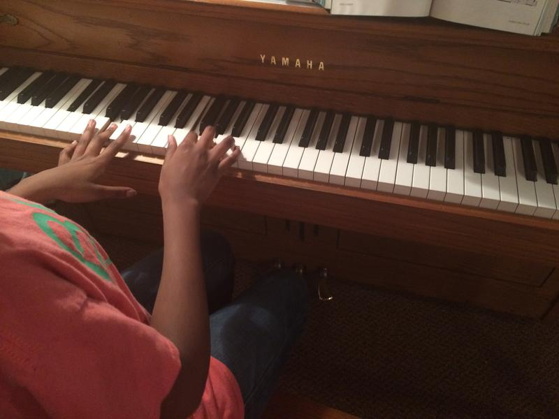 Joanne plays the piano after choir rehearsal. Like many youth in Cape Girardeau she's homeless.
