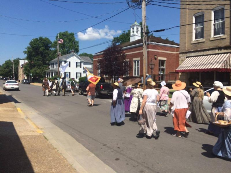 Community members walk through downtown Ste. Genevieve during the opening promenade.