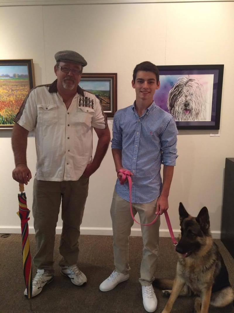 Local artist Randy Hays, left, and his son Landon Hays, right, came out to showcase Randy's work for First Friday of the Arts.